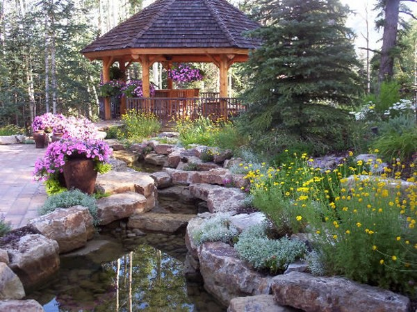 man made creek installation with gazeebo